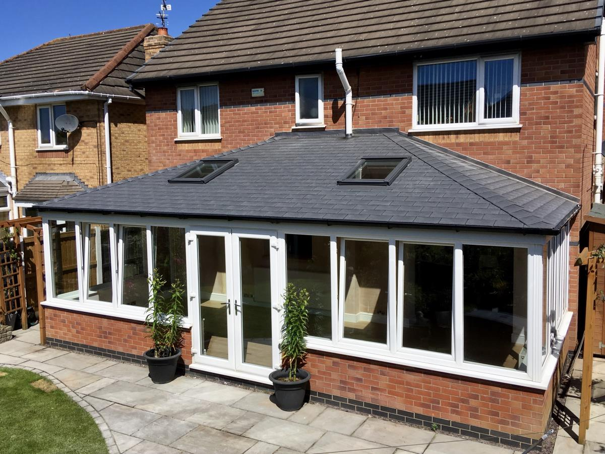 Grey tapco slate roof with velux windows for large conservatory in Bispham.
