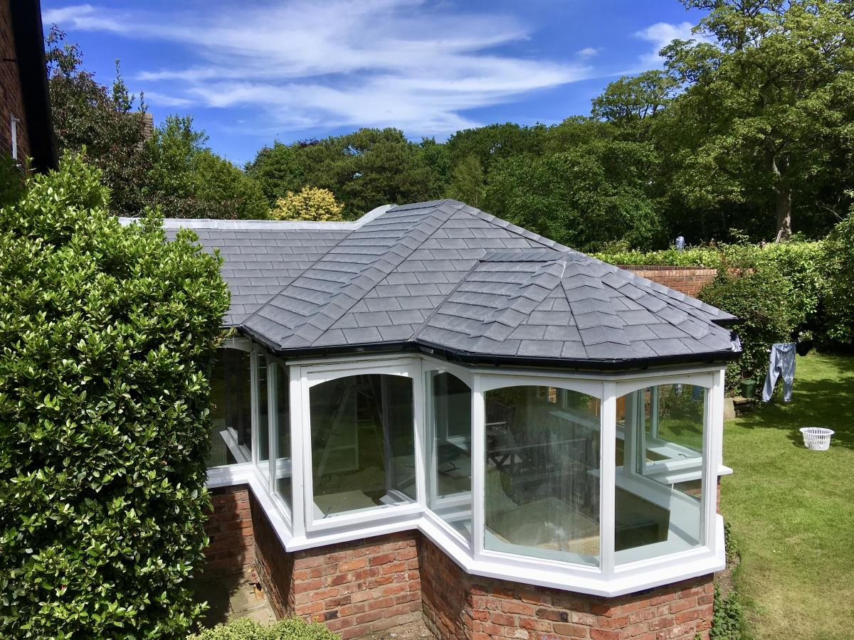 Solid roof in grey tapco slate style for an interesting Lytham conservatory.