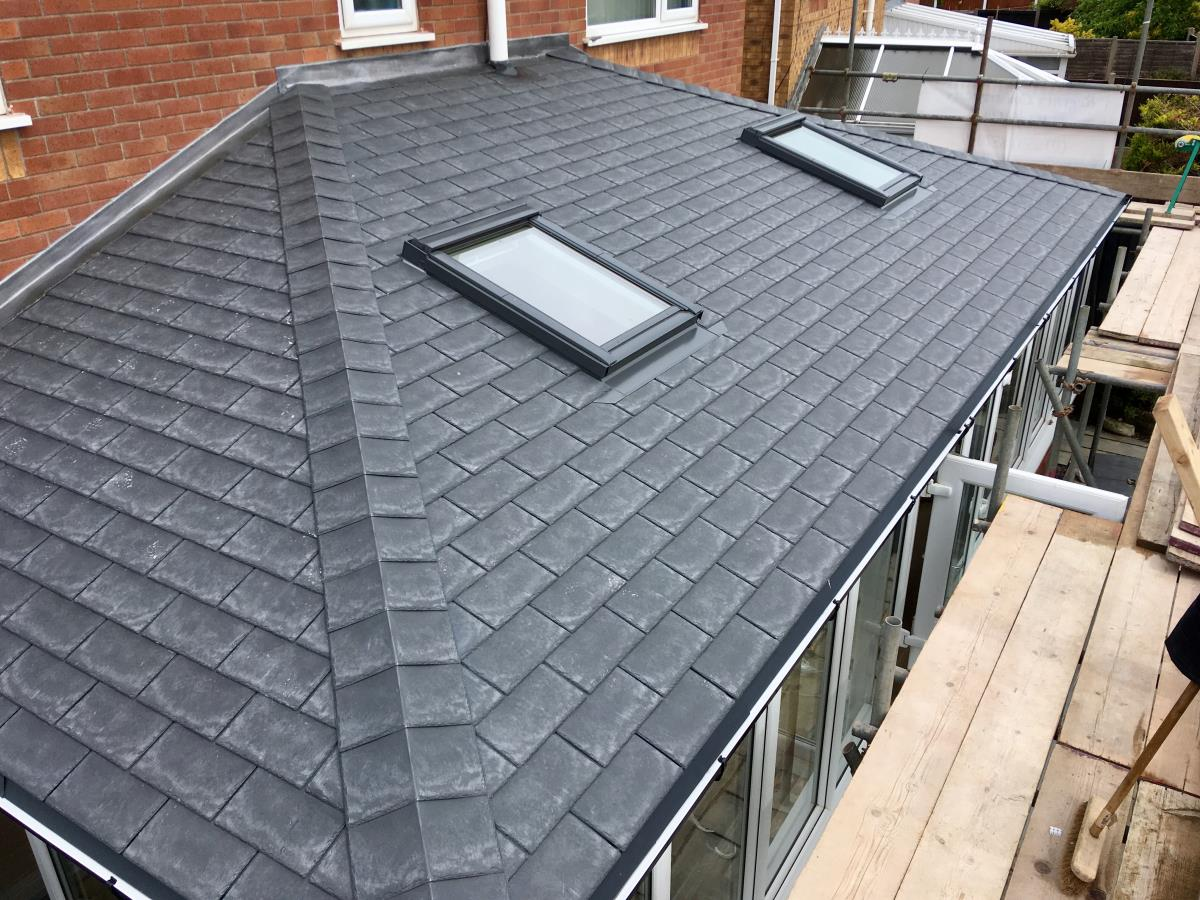 Top view of an installation with velux windows on a slate style conservatory roof.