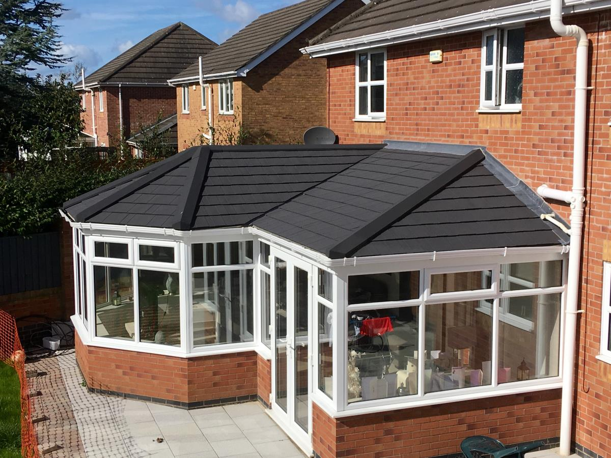 Ebony metrotile shingle solid roof conversion for a P-shaped conservatory in Norcross, Blackpool.