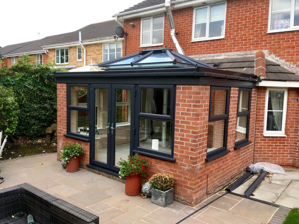 An orangery in Poulton-le-Fylde with an anthracite flat roof and lantern.