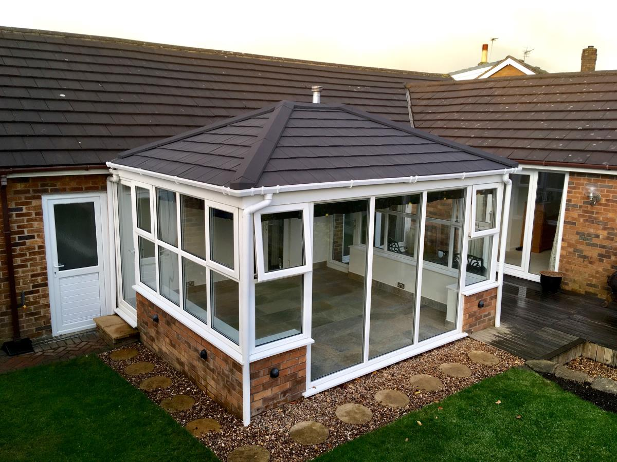 An ebony metrotile shingle conservatory roof to match the existing house tiles in Stanah, Thornton.