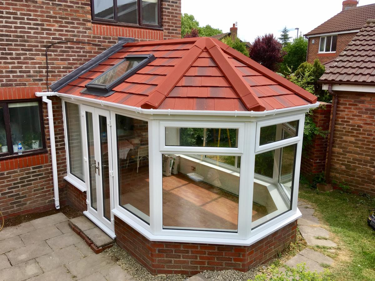 Antique red conservatory roof for five sided garden room with velux windows in Cleveleys.