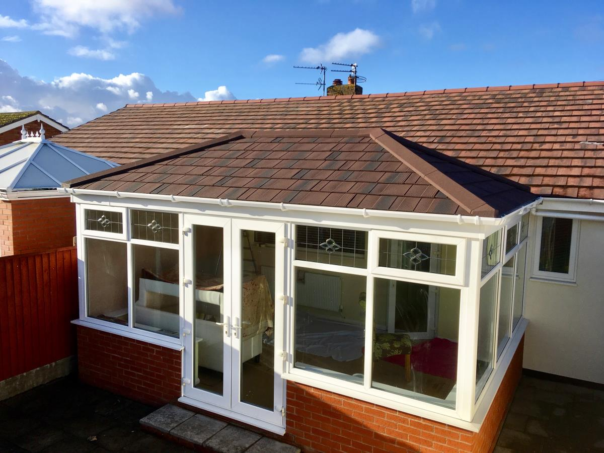 Replacement conservatory roof for a Rossall (Fleetwood) customer in burnt umber to match their property.