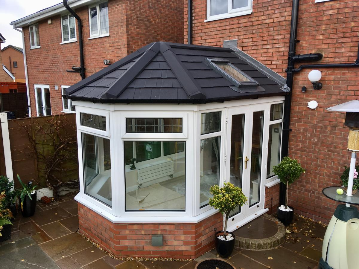 Victorian roof conversion in ebony metrotile shingle for a Cleveleys conservatory.