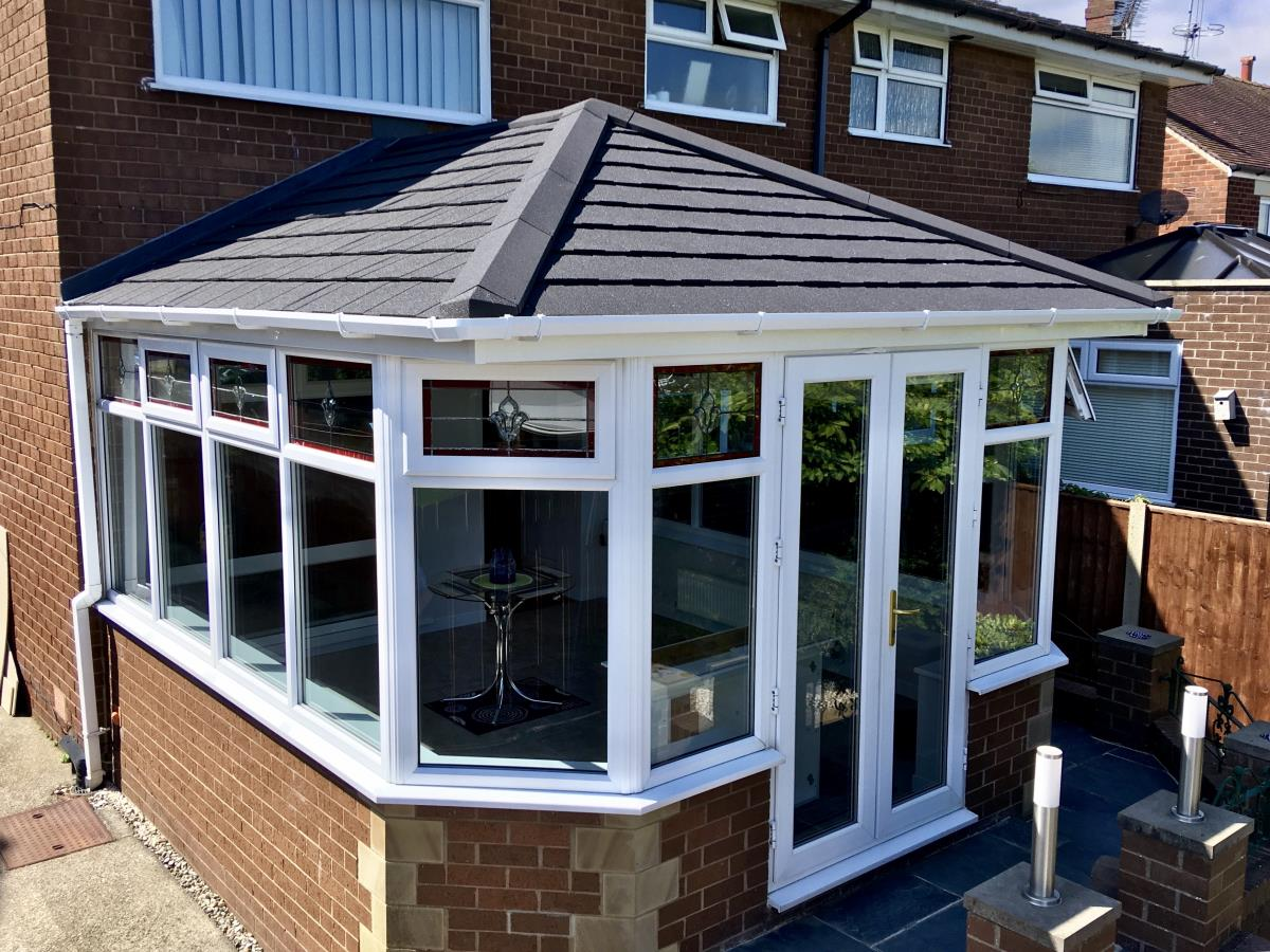 Ebony metrotile solid roof conversion for a Georgian style conservatory in Kirkham.