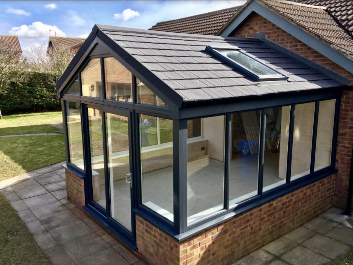 A gable fronted metrotile roof conversion with velux window for a Poulton-le-Fylde conservatory.