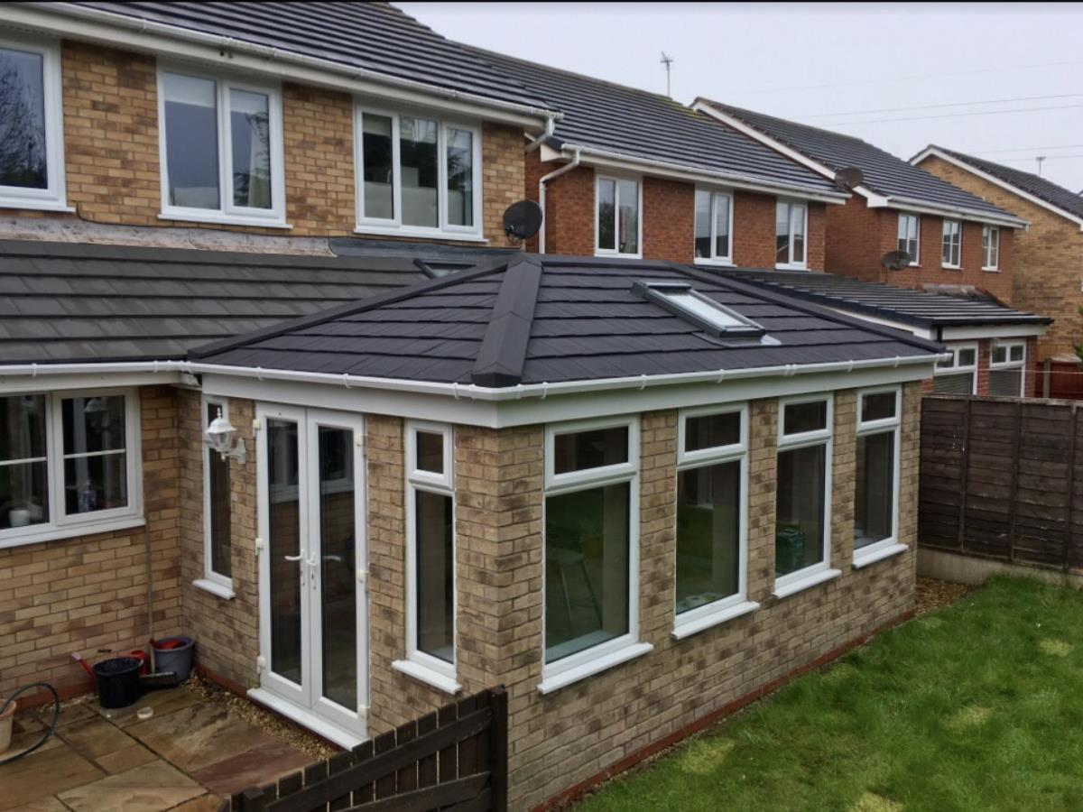 Ebony metrotile shingle styled conservatory roof with a velux window for a Blackpool client.