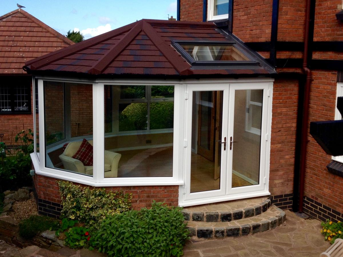 Conservatory roof conversion featuring a burnt umber shingle roof for a Cleveleys property.