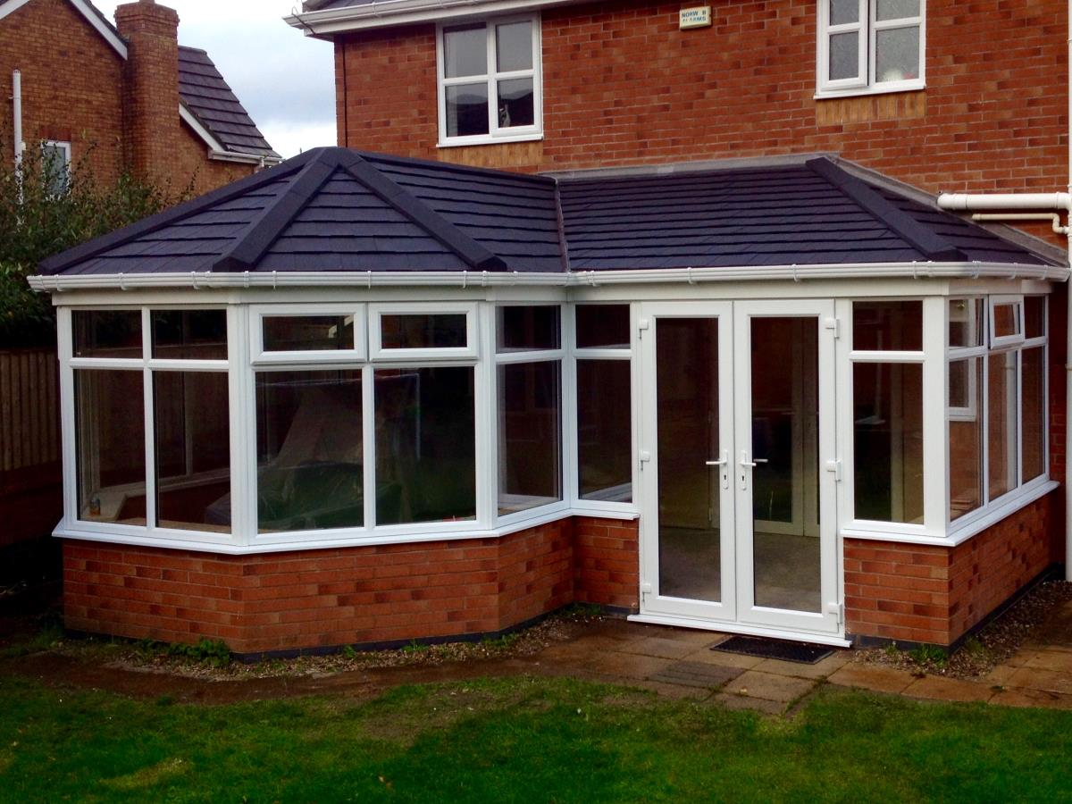 Ebony shingle style roofing for a p-shaped conservatory in Blackpool.