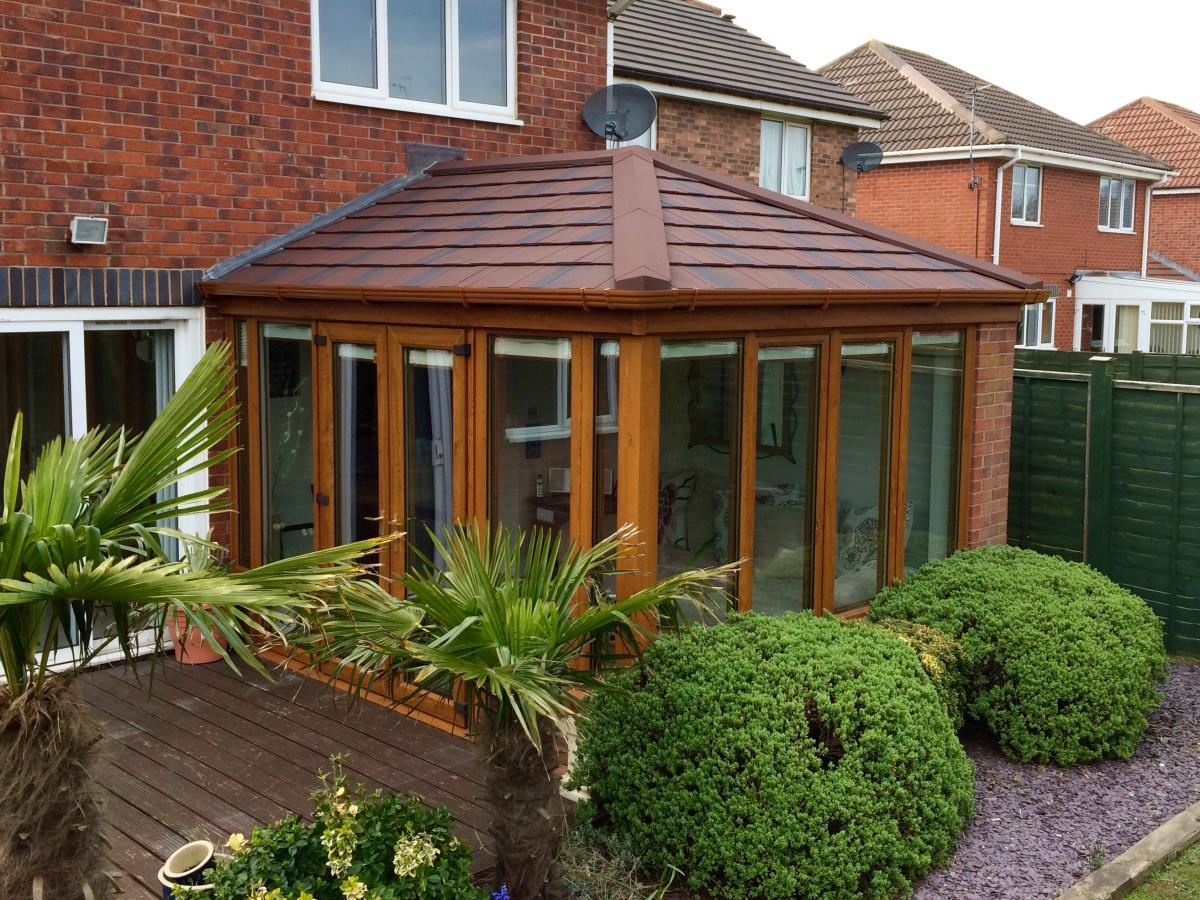 Georgian style conservatory roofing in burnt umber for a client on the Fylde Coast.