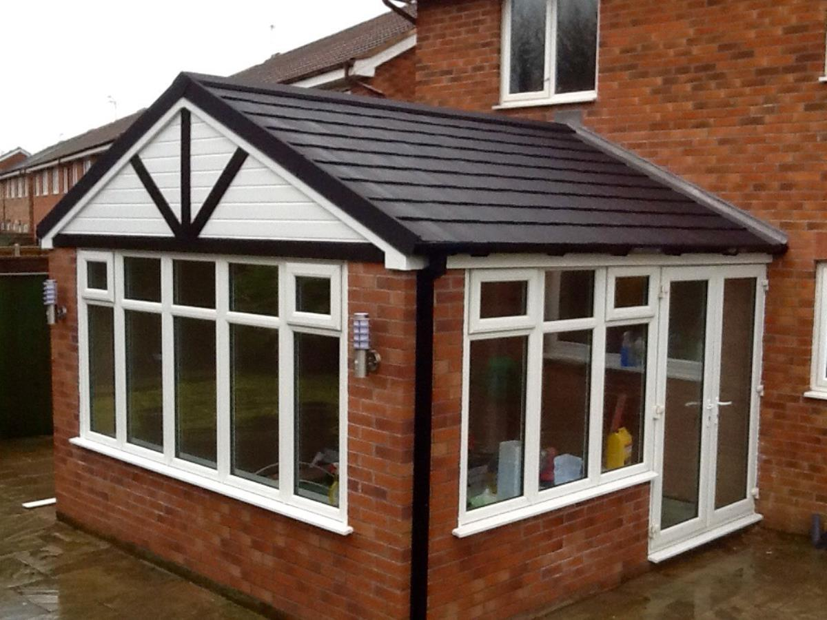 Replacement gable fronted ebony shingle roof for orangery style extension in Thornton.