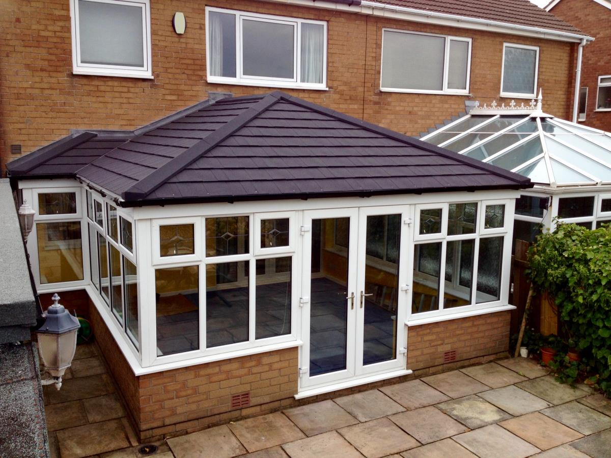 Georgian style conservatory roofing in ebony colouring for Blackpool home.