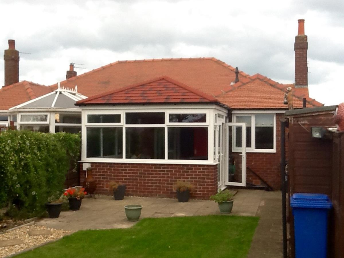 Antique red shingle style roofing for a Cleveleys conservatory, replacing the original glass.