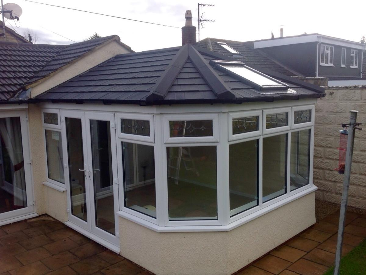 Ebony coloured Victorian style conservatory roof conversion for a Fleetwood home.