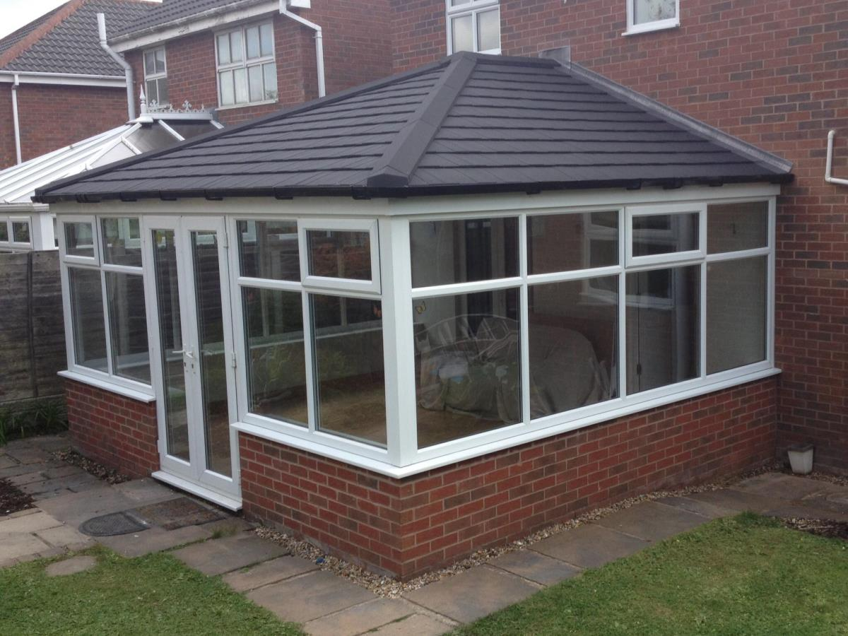 Large ebony shingle Georgian style tiled roofing for a Thornton conservatory.