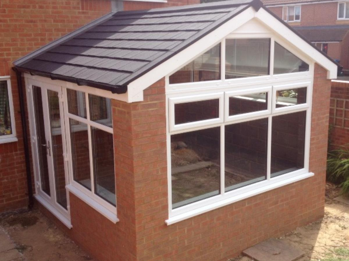 Gable fronted ebony shingle style tiled roofing for a St Annes conservatory.