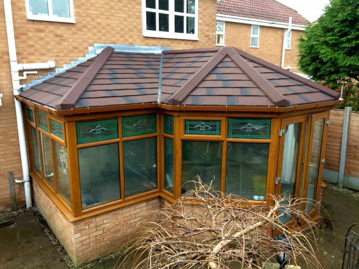 P-shaped burnt umber solid tiled conservatory roofing for a Thornton client.