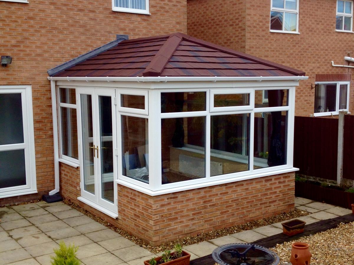 Umber shingle styled tiling for a conservatory roof in Thornton.