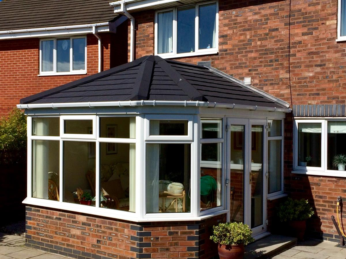 Replacement Victorian style black tiled roofing for a Cleveleys conservatory.