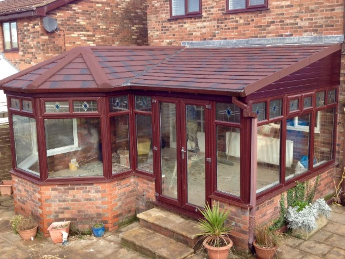 Umber shingle styled solid conservatory roof conversion for a property in Singleton, Poulton-le-Fylde.