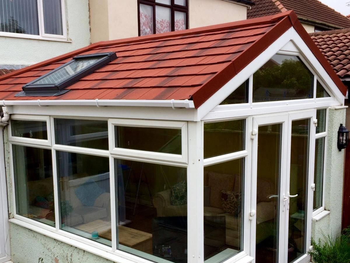 Antique red tiled gable roof with Velux window for a client's conservatory in Knott End, Over Wyre.